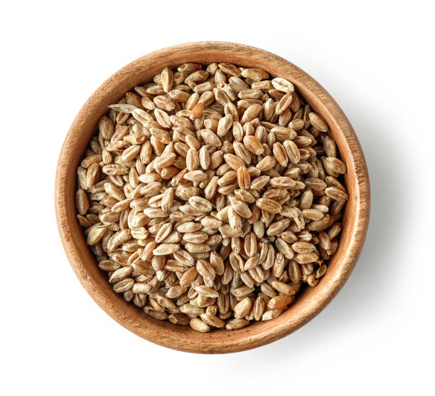 wooden bowl of wheat grains - barley stock pictures, royalty-free photos & images