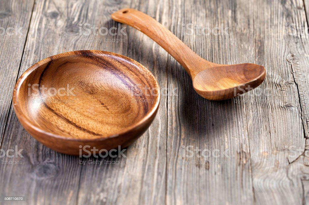 Wooden bowl with ladle stock photo