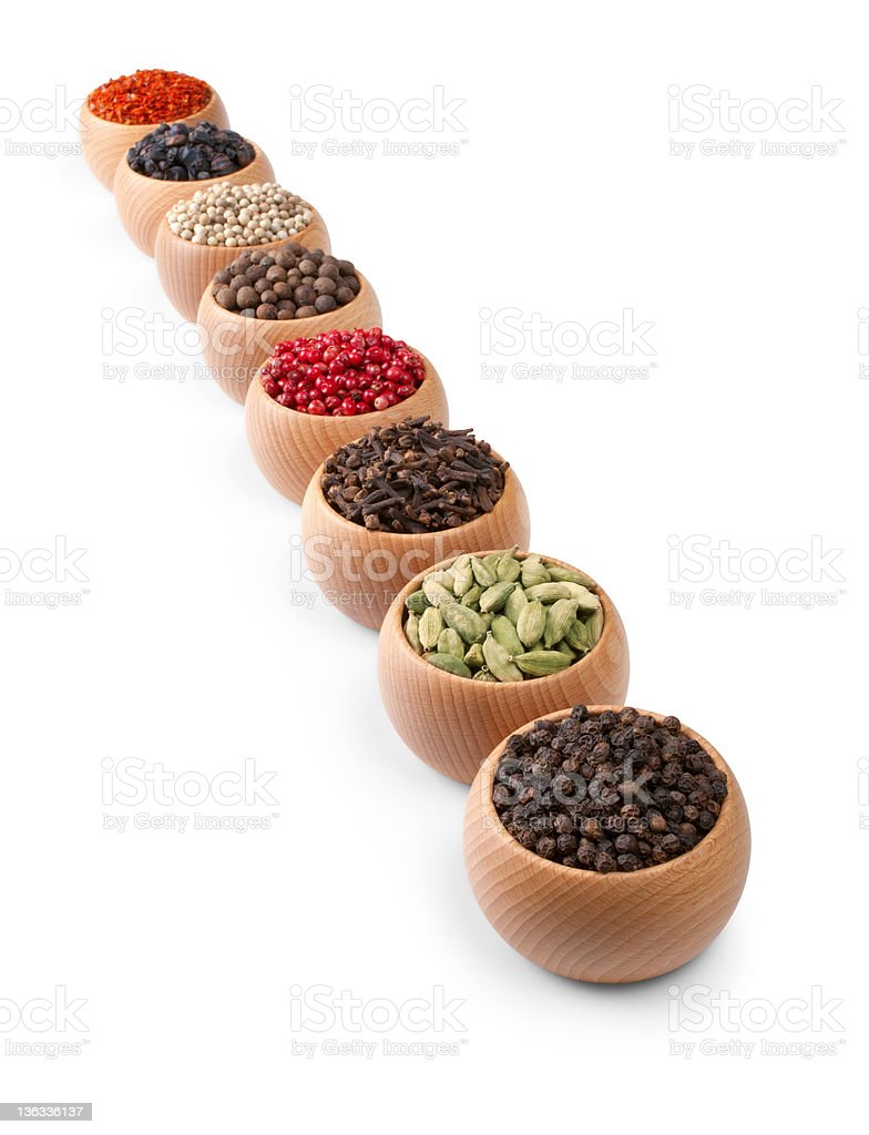 Wooden bowls full of different spices and herbs royalty-free stock photo