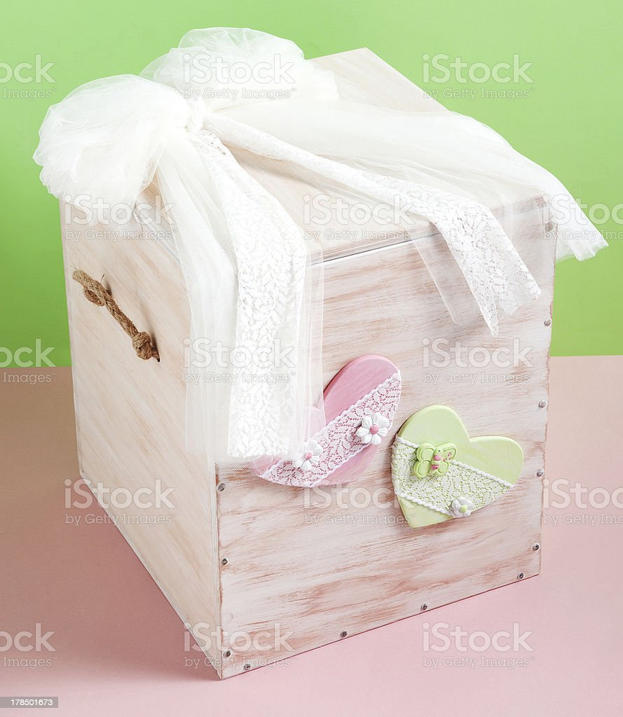 wooden box for baptismal clothes green and salmon background royalty-free stock photo