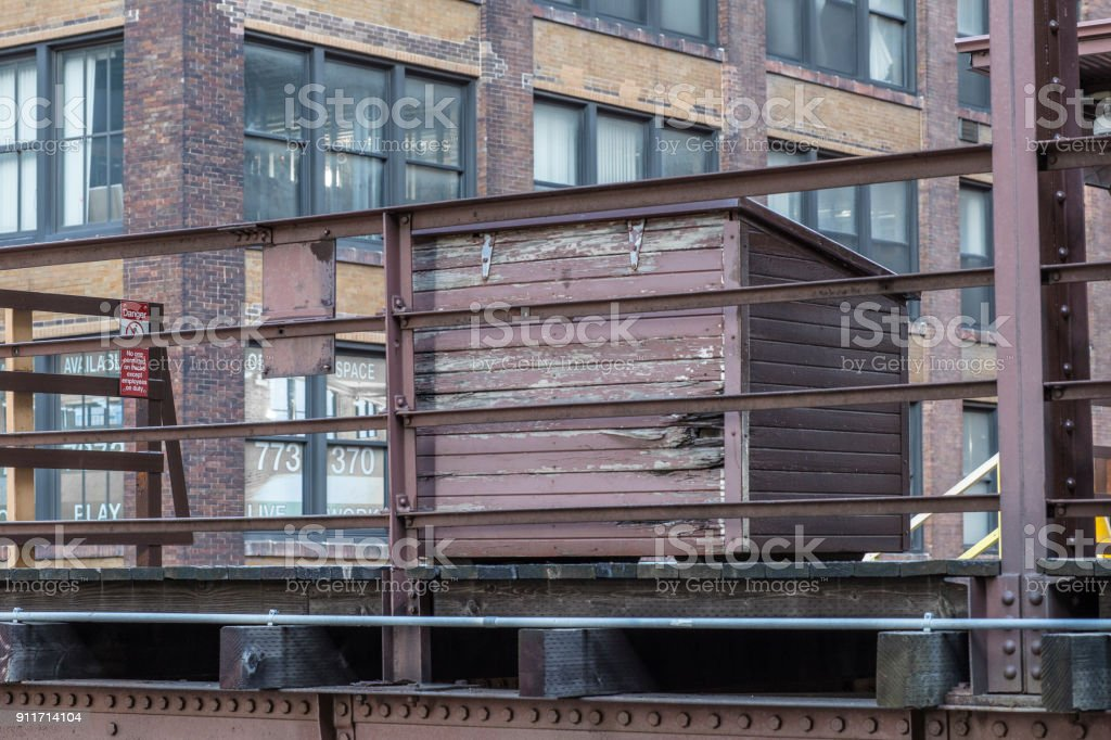 Wooden box sitting on elevated platform stock photo