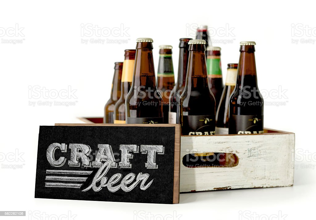 Wooden box with beer bottles and sign stock photo