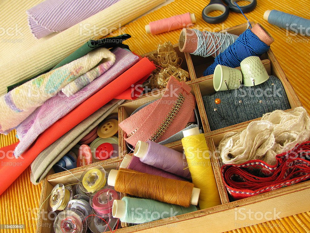 Wooden box with colored sewing utensils stock photo