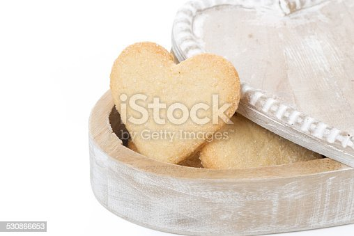 wooden box with cookies in the form of heart, isolated on white