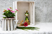 Wooden box with frog decoration and flowers