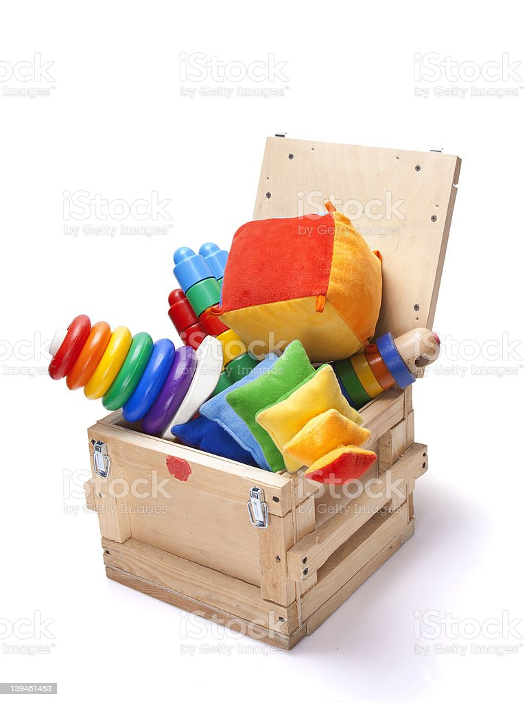 wooden box with many toys stock photo