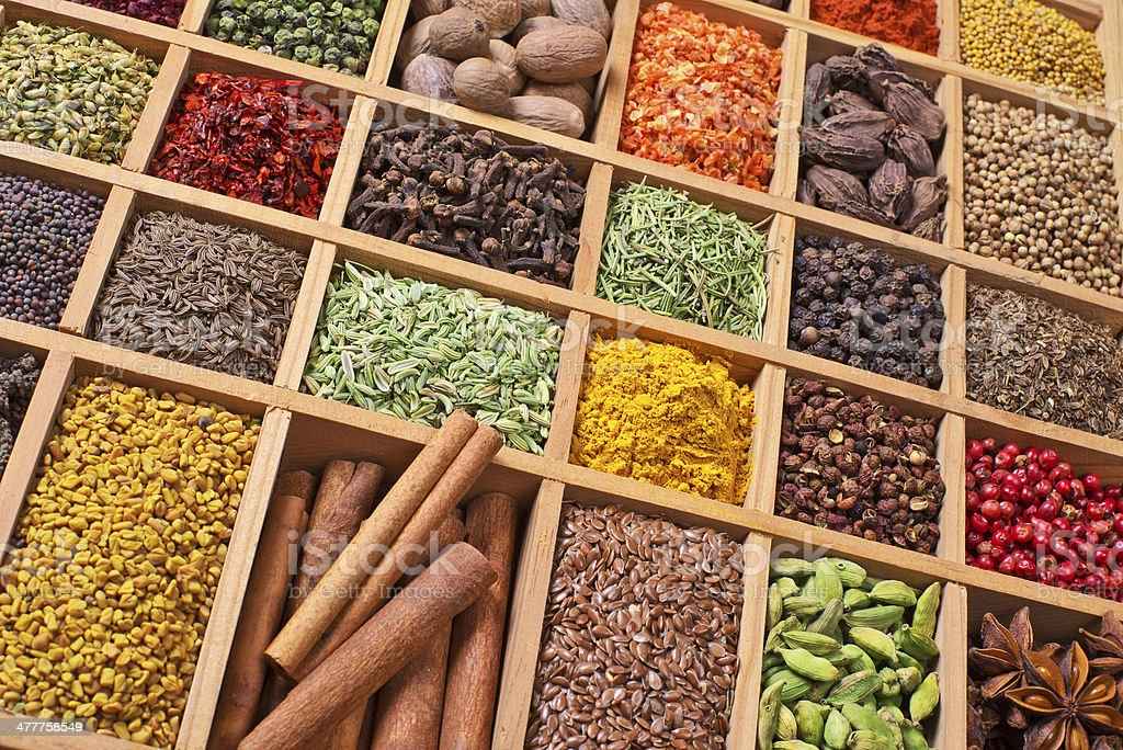 wooden box with spices and herbs stock photo