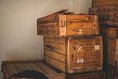 Wooden boxes (containers) containing medical and emergency services equipment in the old warehouse covered with the sunlight.