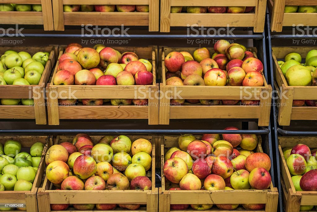Wooden boxes of apples in the supermarket stock photo