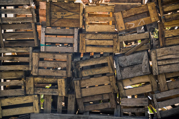 wooden boxes stacked forming a wall stock photo