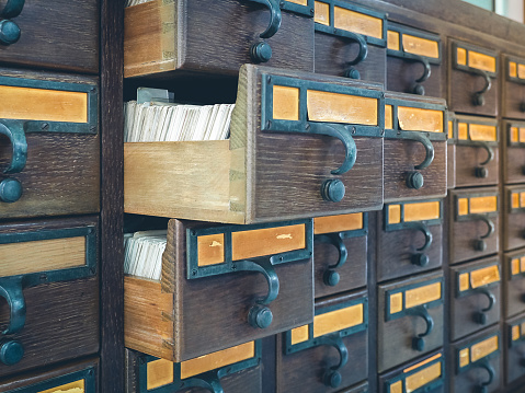Wooden boxes with index cards in library