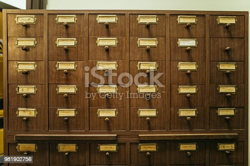 668340340istockphoto Wooden boxes with index cards in library 981902756