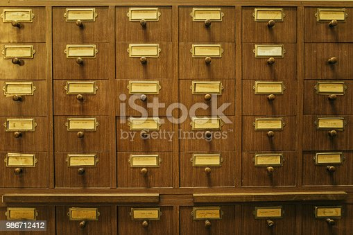 668340340istockphoto Wooden boxes with index cards in library 986712412