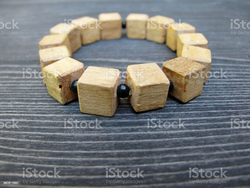 Wooden bracelet. Wood block craft ideas stock photo