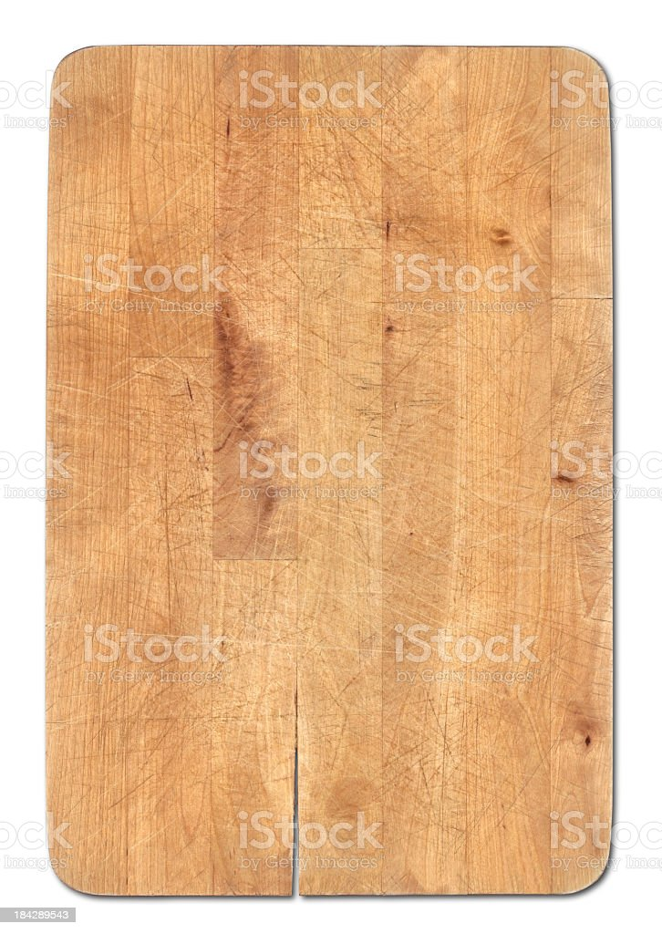 Wooden bread cutting board isolated on white, knife's cuts visible stock photo