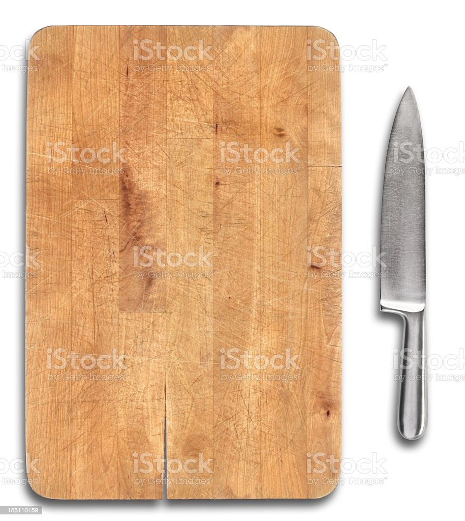 Wooden bread cutting board with stainless steel knife isolated stock photo