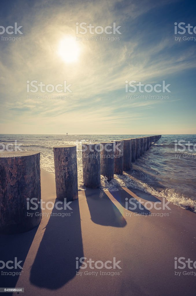 Wooden breakwater - Baltic seascape at sunset, Poland stock photo
