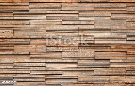 istock Wooden bricks slate wall texture background 636962052