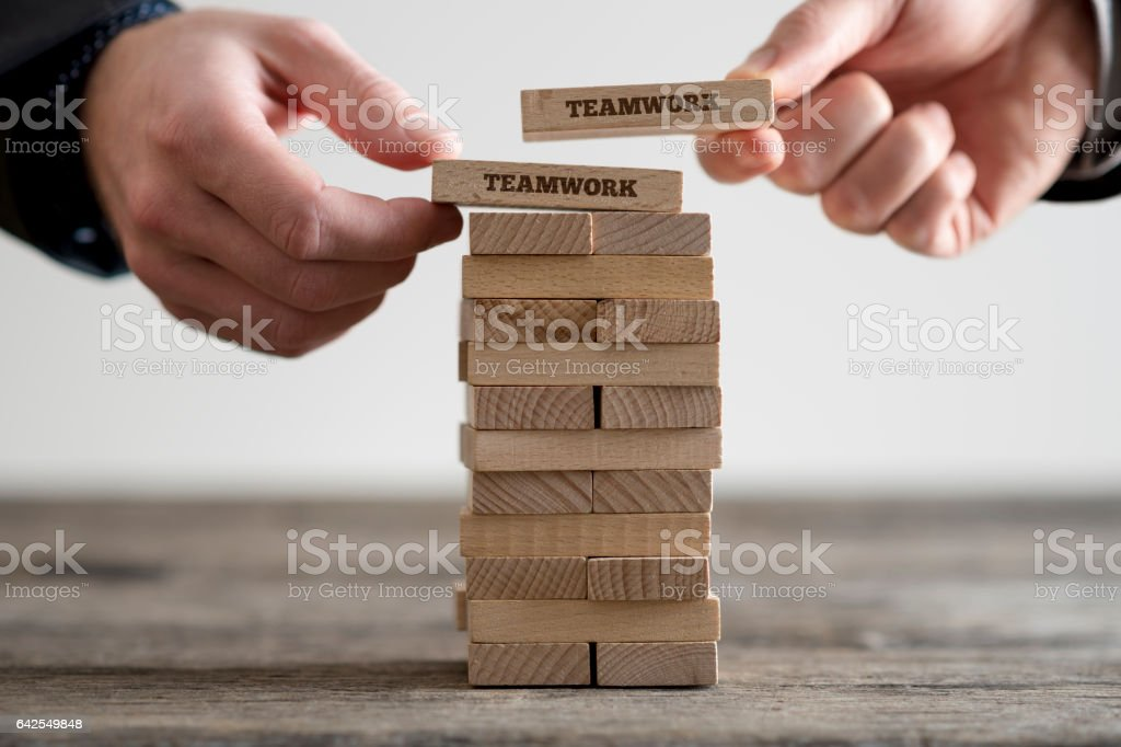 Wooden bricks with teamwork business signs stock photo