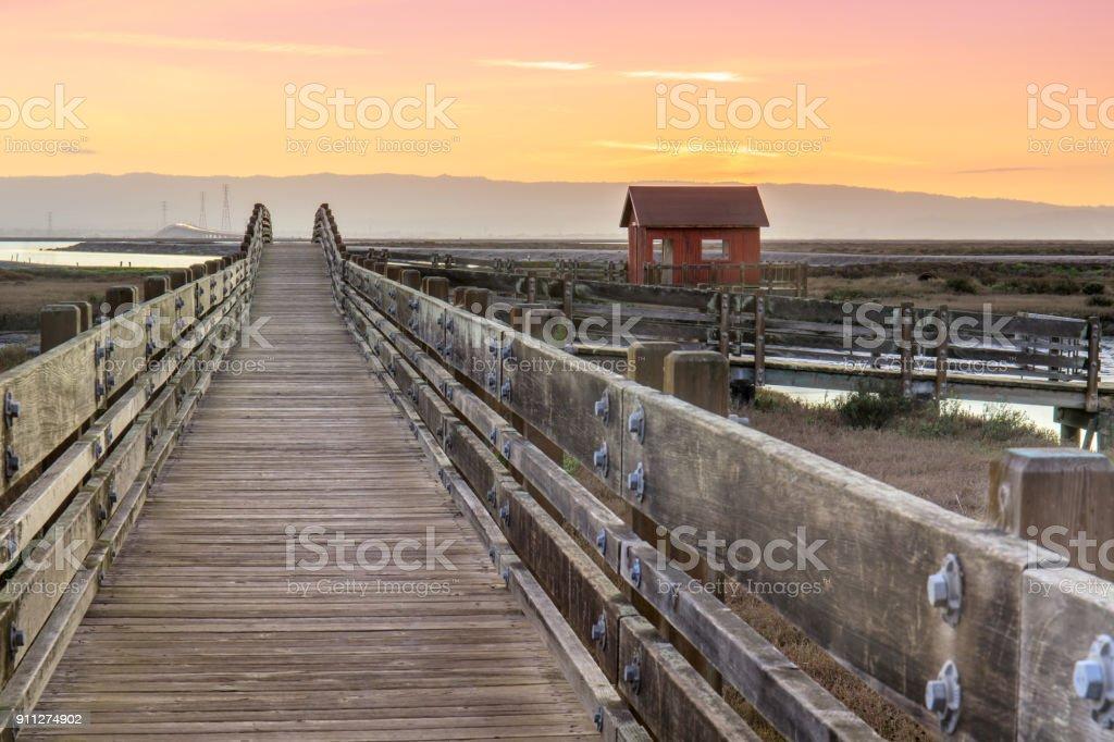 Wooden Bridge and Cabin Landscape stock photo