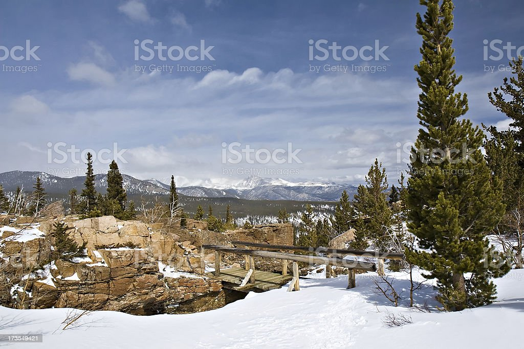 Wooden Bridge and Snowy Mountain Landscape, Rocky Mountain National Park stock photo