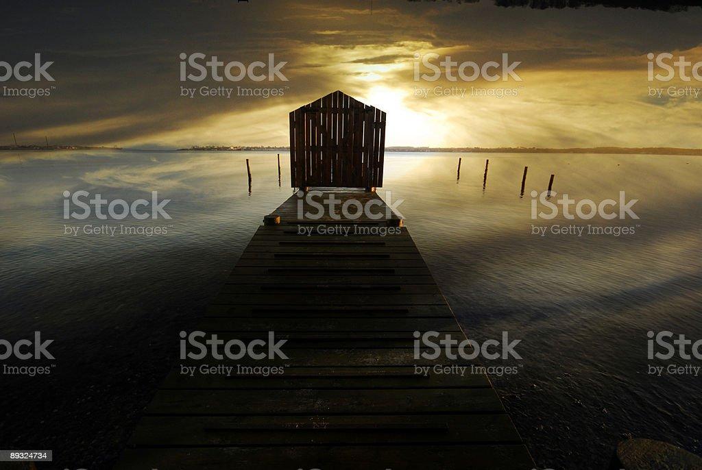 Wooden bridge and sunrise royalty-free stock photo