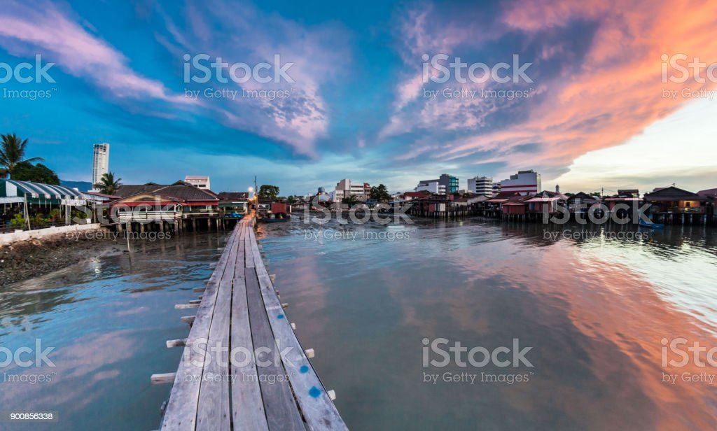 Wooden bridge Clan Tan Jetty view during sunrise in George Town, Penang stock photo
