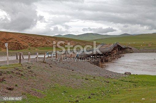 Hazardous wooden bridge crossing the Orkhon River in the Orkhon valley.