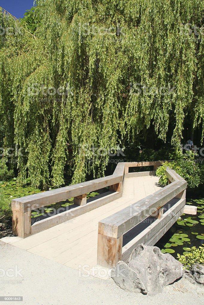 Wooden bridge in an oriental garden royalty-free stock photo