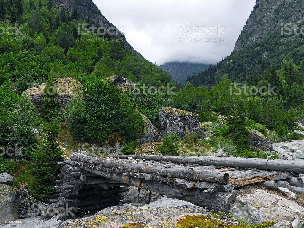 Wooden bridge in mountains royalty-free stock photo