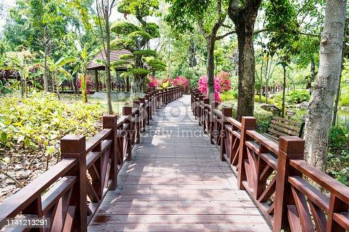 Wooden bridge in public park.
