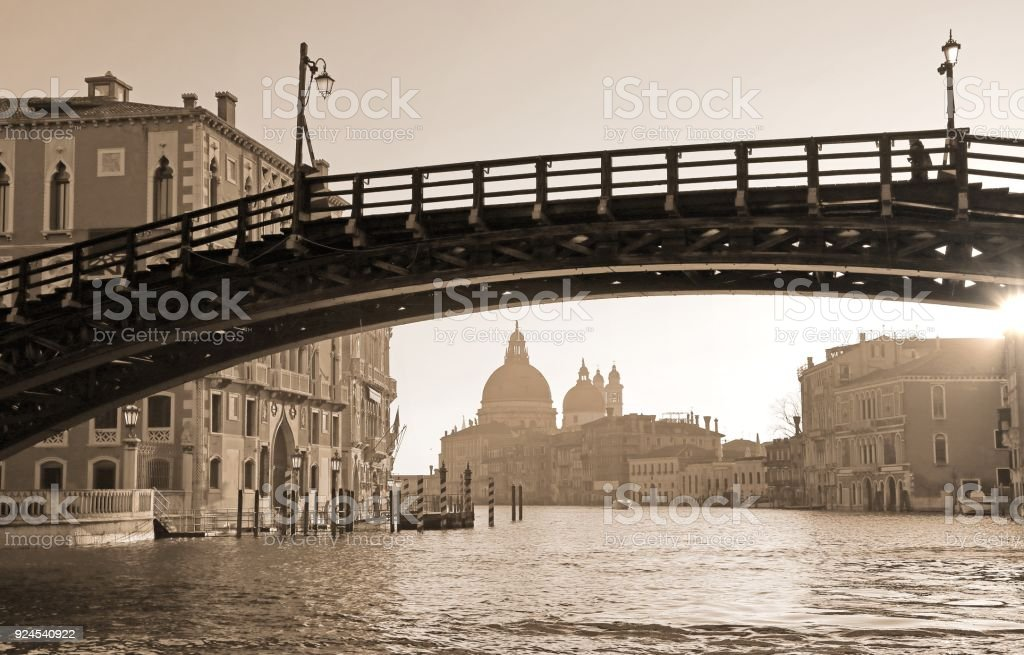 wooden bridge in Venice Italy called Ponte della Accademia with sepia toned stock photo