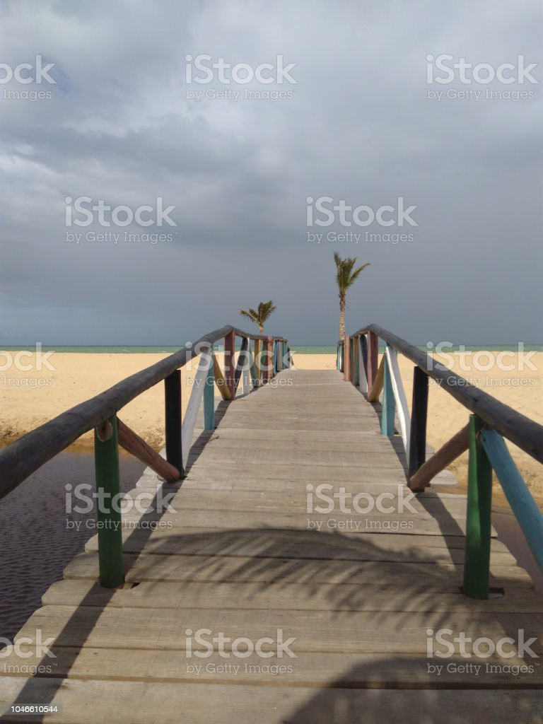 Wooden bridge on the beach stock photo
