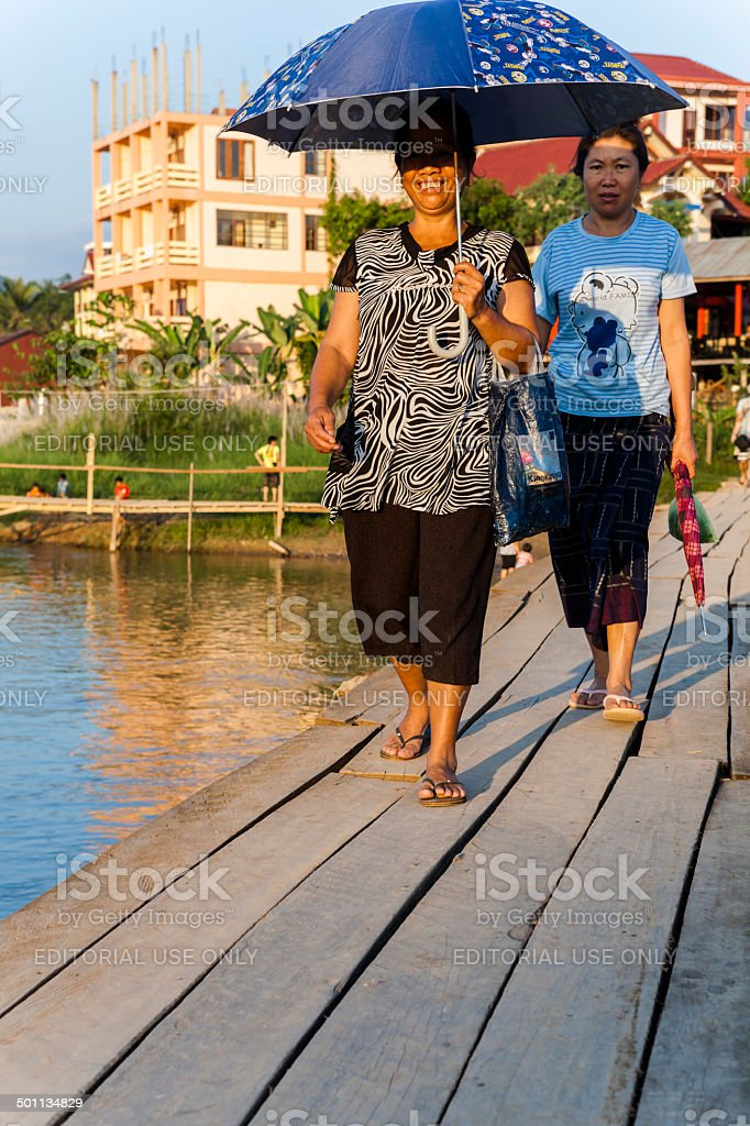 Wooden bridge on the river from Vang Vieng stock photo