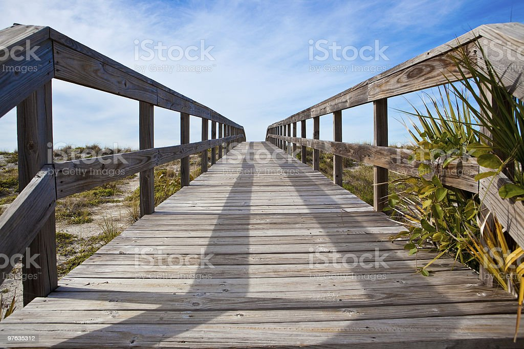 Wooden bridge over dunes leading to beach in Florida. royalty-free stock photo