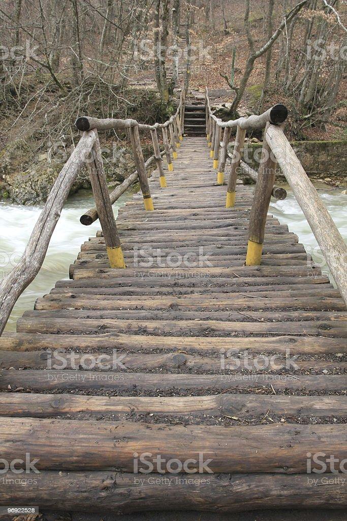 wooden bridge over mountain river royalty-free stock photo