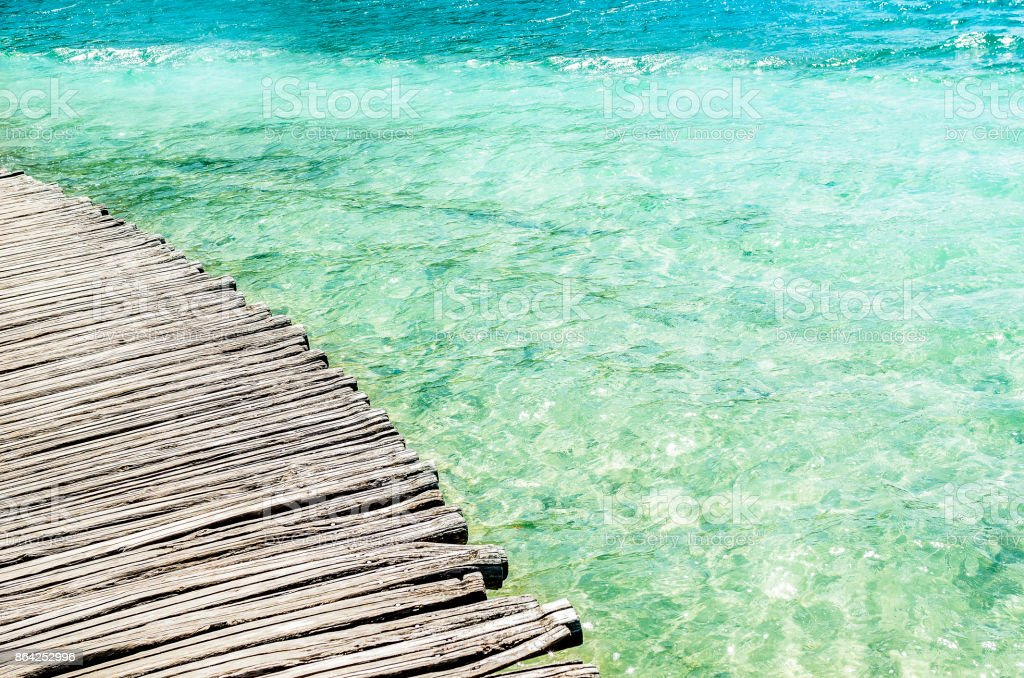 Wooden bridge over the water. royalty-free stock photo