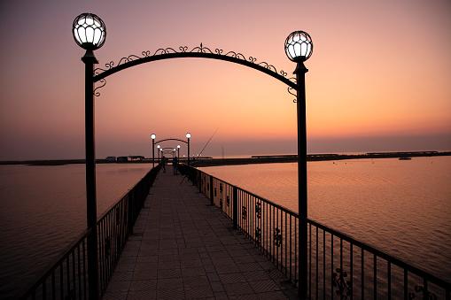 Wooden bridge pier, Twilight on the sea
