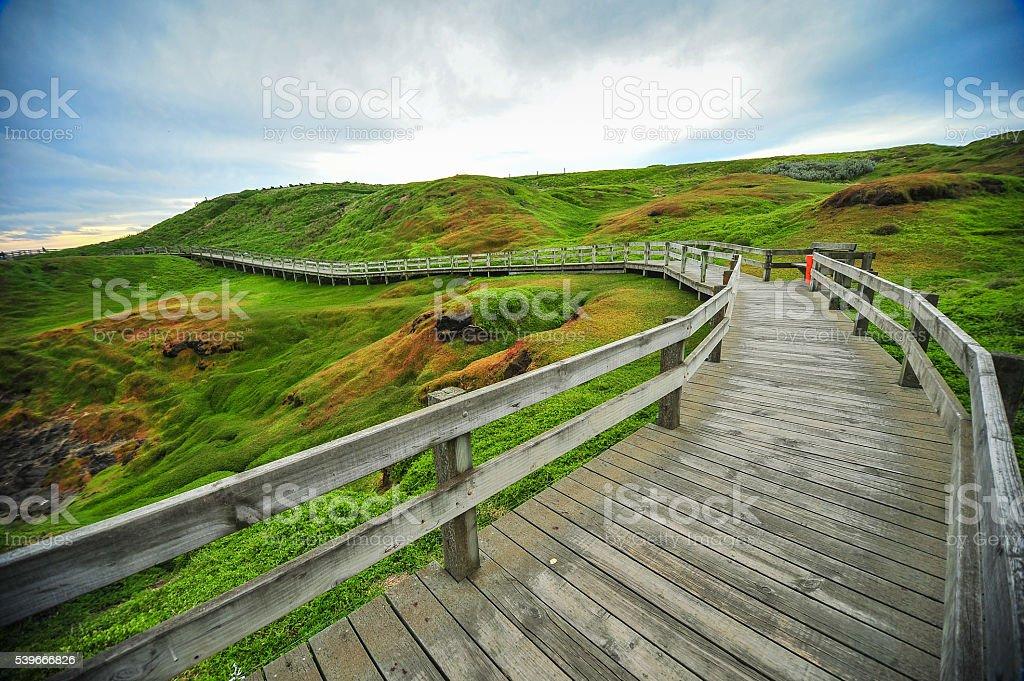 Wooden bridge stairs Nobbies Phillip Island Australia stock photo