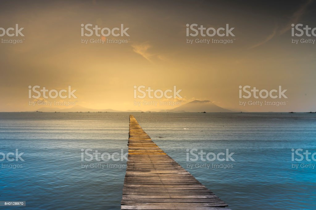 Wooden bridge to the sea stock photo