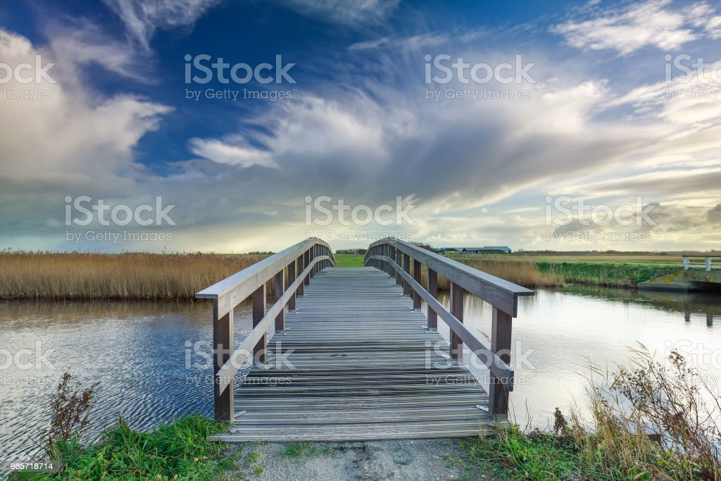 wooden bridge via river and blue sky, Netherlands - Royalty-free Blue Stock Photo