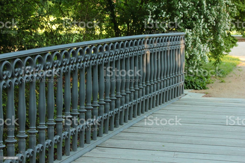 wooden bridge with a metal balustrade royalty-free stock photo
