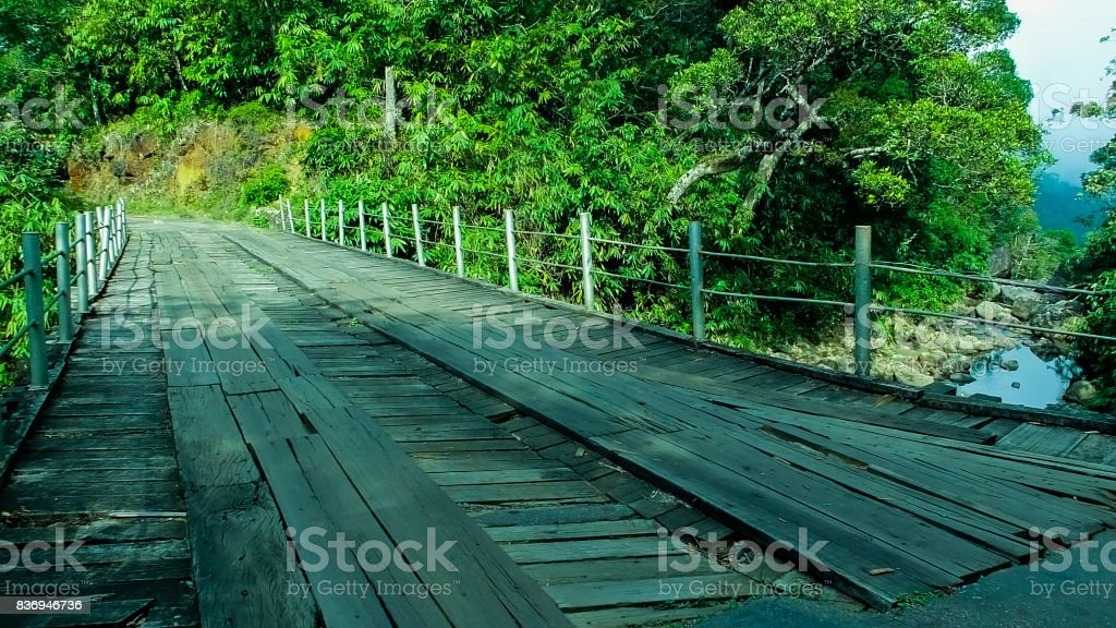 Wooden Bridge with Steel suspension stock photo