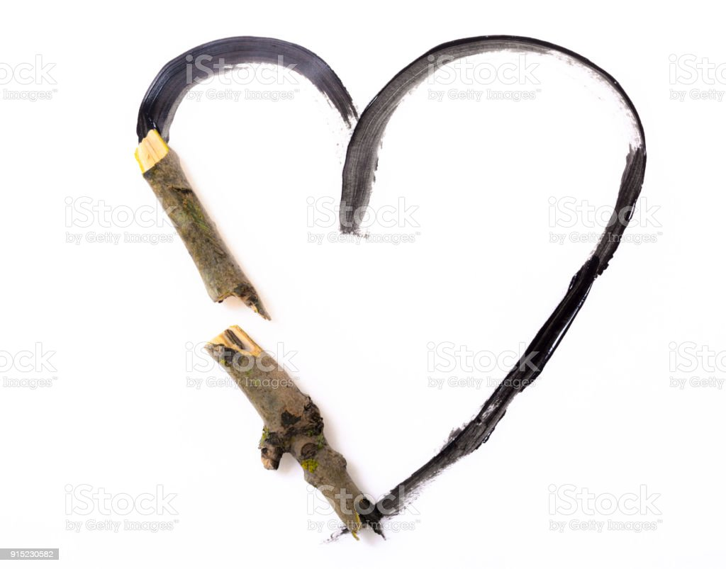 Wooden broken heart made with in forest found snapped branches stock photo