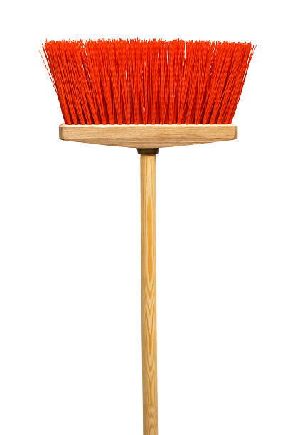 Wooden broom with red bristles on a white background Beautiful red mop on a white background broom stock pictures, royalty-free photos & images