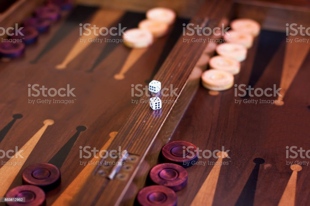 Wooden brown backgammon game with the dice stock photo