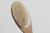 istock Wooden brush with natural bristle for body massage. Cellulite treatment tool 1141969529