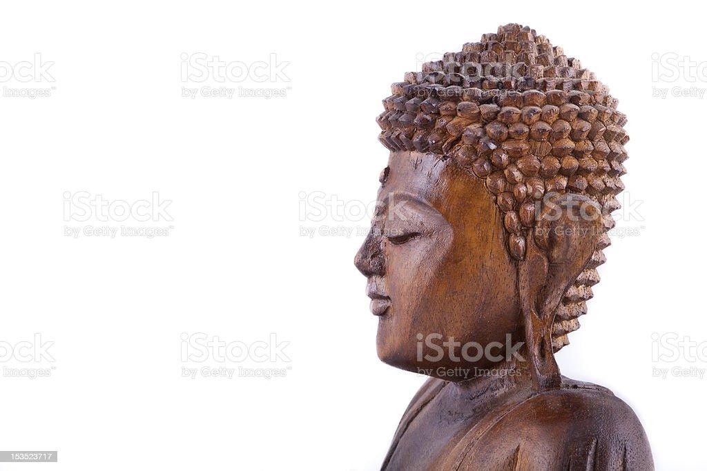Wooden Buddha on white background royalty-free stock photo