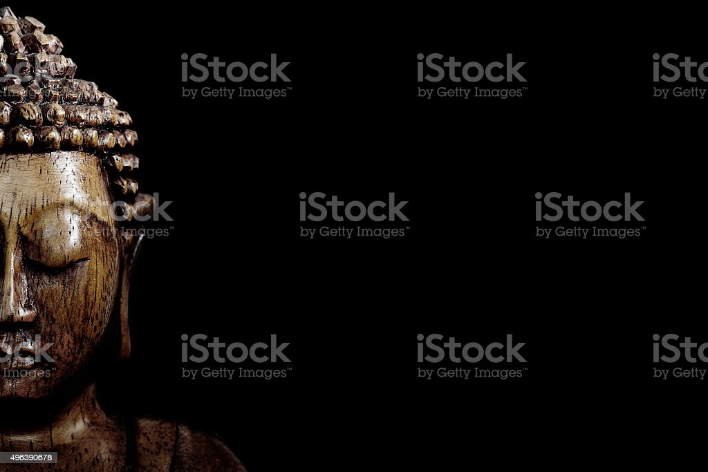 Wooden buddha statue stock photo