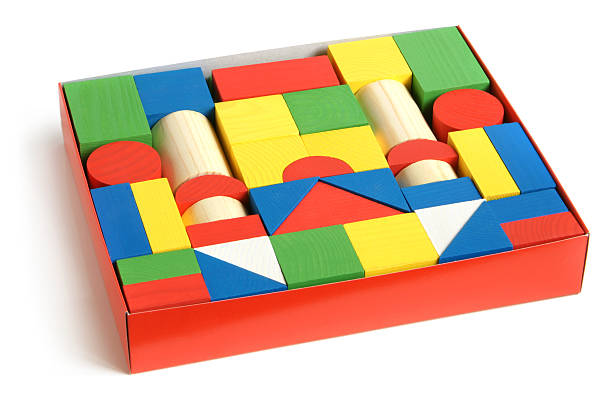 Wooden building blocks in box stock photo